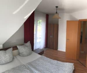 Schlafzimmer im Appartement - Pension am Weissen See